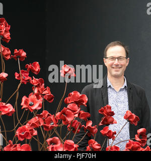 Manchester, UK.7th Sept 2018. The iconic poppy sculpture Wave by  designer Tom Piper at IWM North. This is the final presentation of Wave as part of 14-18 commemoration. It is the first time that Manchester has hosted one of these artworks. The installation 'Blood Swept Lands and Seas of Red' poppies an original concept by artist Paul Cummins and installation designed by Tom Piper. The installation was originally at HM Tower of London where 888,246 poppies were displayed. Credit: MediaWorldImages/Alamy Live News - Stock Photo