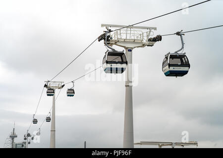 Telecabine Lisboa at Parque das Nacoes (Park of Nations) in Lisbon, Portugal,   The cable cars overlook the Vasco da Gama bridge on the Tagus river. - Stock Photo