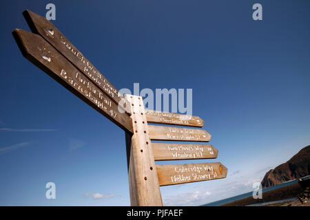 signs showing the various walks and mileage from Lynmouth, North Devon. Tarka trail, South West coastal path, two moors way, Coleridge way. - Stock Photo