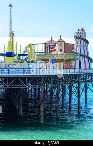 Helter skelter and various rides at the end of the Victorian Brighton Palace Pier, Brighton, East Sussex.