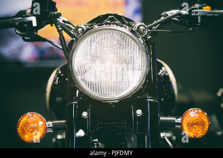 Close-up view of motorcycle headlight. Vintage classic Motorcycle headlight or head lamp. - Stock Photo