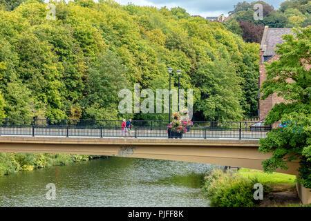 Durham city centre street scene along River Wear and New Elvet Bridge - Stock Photo