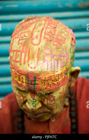 A portrait of a Hindu devotee they clelebrate Holi Festival writing radhe krishna on face at nandgaon  Mathura  Uttar Pradesh  India Asia, - Stock Photo