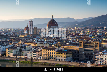 Florence, Italy - March 22, 2018: Landmarks including the Duomo cathedral stand in the Renaissance cityscape of Florence, with the hills of Monteferra - Stock Photo