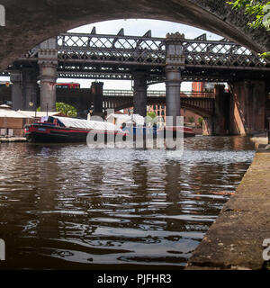 Manchester, England, UK - May 21, 2011: An East Midlands Trains passenger train crosses Castlefield basin on the Bridgewater Canal in Manchester. - Stock Photo
