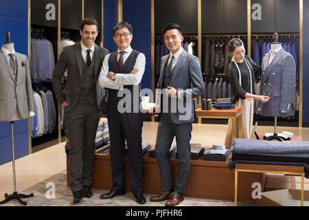 Confident fashion designer and businessmen - Stock Photo
