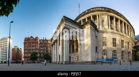 Manchester, England, UK - June 30, 2018: The classical rotunda of Manchester's Central Library stands in St Peter's Square, with the Midland Hotel beh - Stock Photo