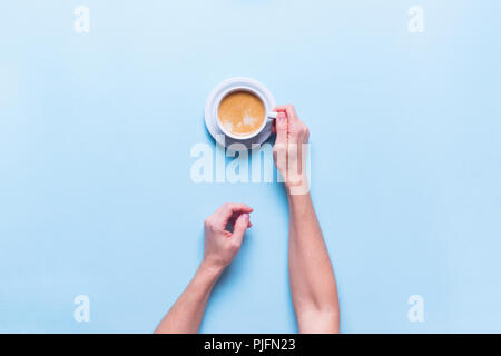 Female Hands Holds Fresh Cup Coffee Color Blue Background Top View Flat Lay Unhealthy Food One Object - Stock Photo