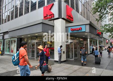 NEW YORK, USA - JULY 1, 2013: People walk past Kmart store in New York. Kmart operates a total of 1,221 stores (2013). - Stock Photo