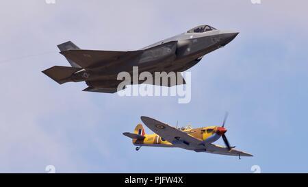 USAF Lockheed Martin F-35A Lightning II flying alongside the BBMF Supermarine Spitfire MK356 at the 2018 Royal International Air Tattoo - Stock Photo