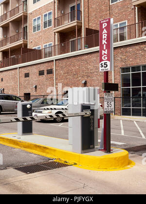 Automated parking lot ticket stand and gate for automobile or car parking only in downtown Montgomery Alabama, USA. - Stock Photo