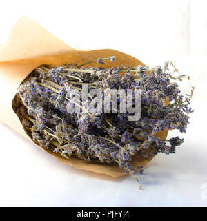 Bouquet of dried lavender in a brown wrapping paper - Stock Photo