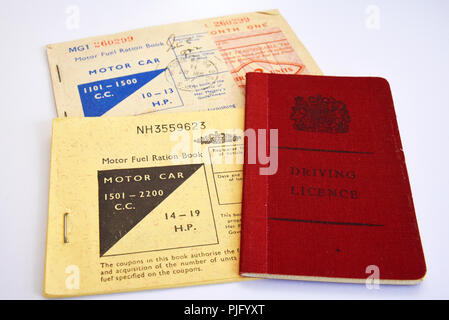 Motor fuel ration book. Petrol rationing. Fuel rations. Coupons for the purchase of motor car fuel, petrol, during post war rationing. Driving license - Stock Photo