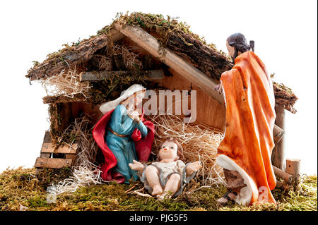 Christmas nativity scene. Hut with baby Jesus in the manger, with Mary and Joseph. Isolated on white background. - Stock Photo