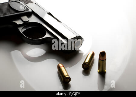 Hand Gun with bullets isolated on white background. Hand gun and bullets close up. Weapons and crime. Gun isolated. - Stock Photo