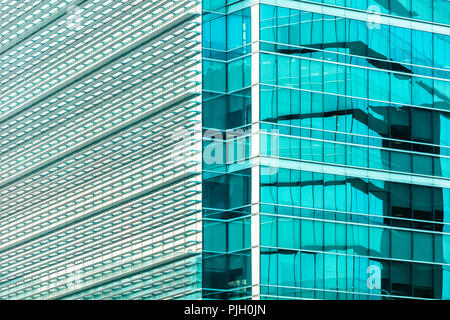 Simple, abstract, pastel color modern glassy office building exterior facade - Stock Photo