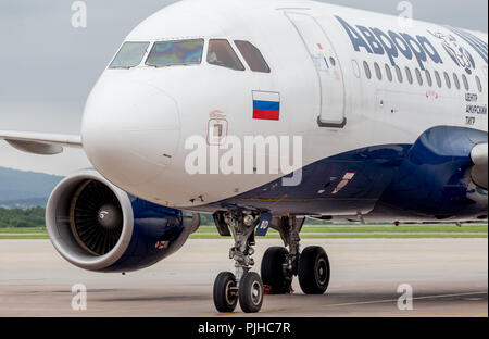 Russia, Vladivostok, 08/10/2018. Passenger airplane Airbus A319 of Aurora Airlines prepares for departure. Aviation and transportation. - Stock Photo