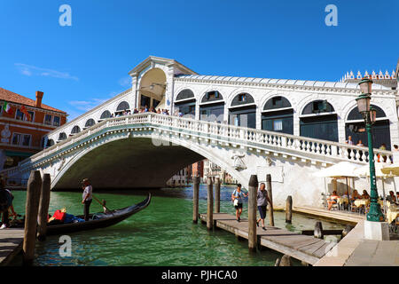 VENICE, ITALY - JUNE 18, 2018: beautiful view of traditional Gondola on famous Canal Grande with Rialto Bridge in Venice, Italy - Stock Photo