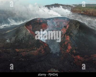 View using an Unmanned Aerial Vehicle into the fissure 8 lava cone in the Kilauea volcano showing a low level of activity September 5, 2018 in Hawaii. After three-months of continuous eruption the volcano has halted activity and appears to be over for the time being. - Stock Photo