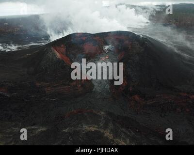 View using an Unmanned Aerial Vehicle into the fissure 8 lava cone in the Kilauea volcano showing a low level of activity September 6, 2018 in Hawaii. After three-months of continuous eruption the volcano has halted activity and appears to be over for the time being. - Stock Photo