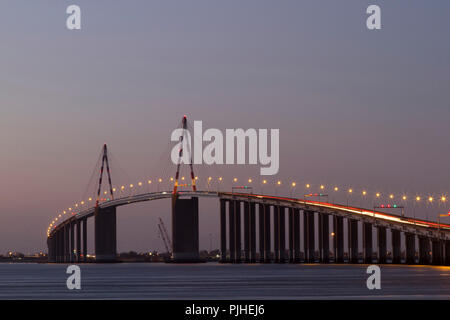 France, estuary of the Loire, St-Nazaire Bridge seen from the left bank of the river, twilight. - Stock Photo