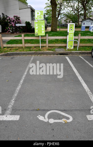 France, parking with charging station for electric vehicles in Lannion city. - Stock Photo