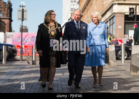 The Prince of Wales and the Duchess of Cornwall, known as the Duke and Duchess of Rothesay while in Scotland, walk on Sauchiehall Street with Lord Provost Eva Bolander, during their visit to the Willow tea rooms Glasgow. - Stock Photo