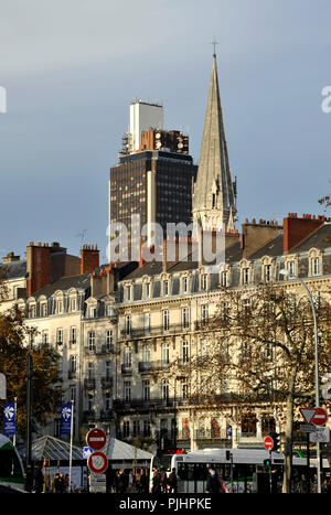 France, Pays de la Loire region, Loire-Atlantique department, downton Nantes City, buildings on Place du Commerce in foreground, Tour of Britain and tower of St. Nicolas church in back. - Stock Photo