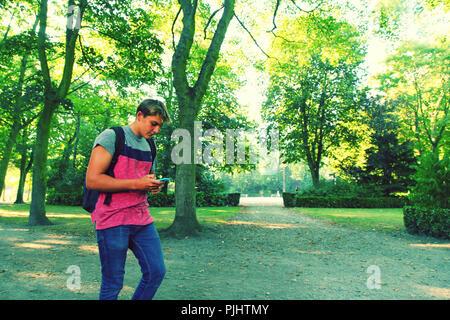 France, teenager playing Pokemon Go. - Stock Photo