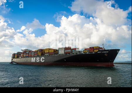 MIAMI, USA - CIRCA AUGUST 2018: Container freight ship 'MSC Lisbon' entering port through a narrow channel at the tip of South Beach - Stock Photo