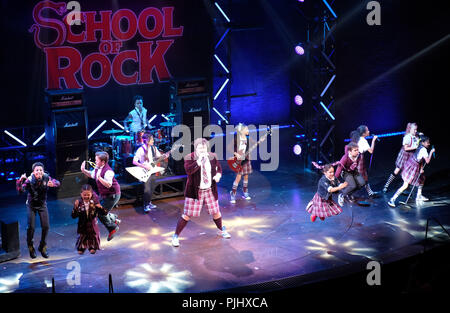 Pic shows: School of Rock finale at Gillian Lynne Theatre in  Drury Lane.  Kids of the cast rock out with Ed Scheebly and Dewey Finn played by Alan Pe - Stock Photo
