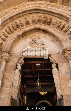 Spain, Galicia, A Coruna, Old Town, Rua Santiago, Iglesia de Santiago, carved stone arch above entrance of ancient church - Stock Photo