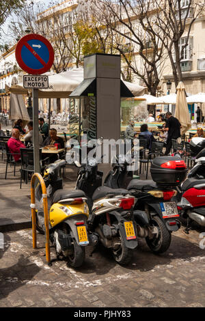 Spain, Cadiz, Plaza del Mentidero, motorcycle parking area - Stock Photo