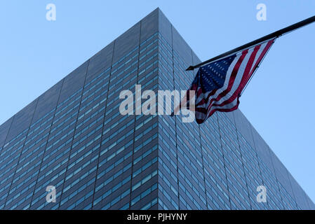 11-2017 New York, USA.  The American flag flying in front of a commercial office building in Manhattan. Photo: © Simon Grosset - Stock Photo