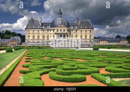 General view of the Vaux-le-Vicomte with a stormy sky from the Le Notre 'à la Francaise' gardens - Stock Photo
