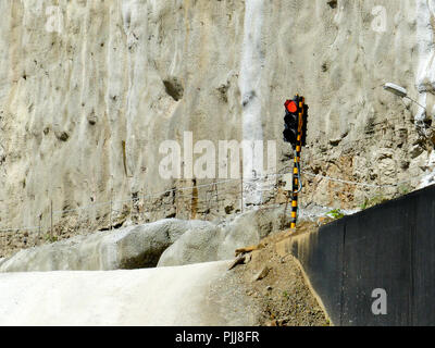 a traffic red light in the middle of a construction site hydropower - Stock Photo