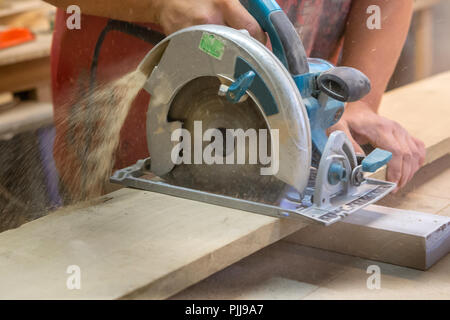 Manual manufacturing of furniture from a natural tree in a workshop. - Stock Photo