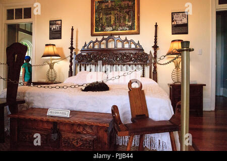 Key West, Florida, USA - September 1, 2018: Cat sleeps on the bed in the bedroom of Ernest Hemingway's House in Key West, Florida. For editorial use. - Stock Photo
