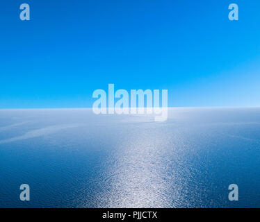 Aerial view of a blue sea water background and sun reflections. Aerial flying drone view. Waves water surface texture on sunny tropical ocean. Aerial  - Stock Photo