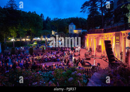 North Wales, UK. 7th September 2018. Festival No. 6 is multi-award-winning music, arts and culture festival that all takes place in the beautiful fairy tale setting of Portmeirion, North Wales, home of the cult TV show The Prisoner. A festival goers enjoying the weather and festival at Festival Number 6, Portmeirion. Day one of Festival Number 6 Credit: DGDImages/Alamy Live News - Stock Photo