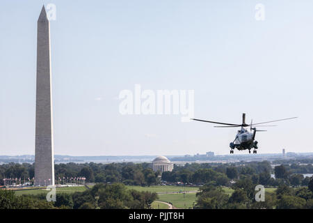 Marine One, aboard with President Donald J. Trump, flies from the South Lawn of the White House to the Washington Monument and Jefferson Memorial on Thursday, September 6, 2018, en route to Joint Base Andrews for his trip to Billings, Montana  People:  President Donald Trump - Stock Photo