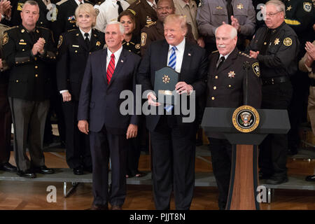President Donald J. Trump, joined by Vice President Mike Pence, poses for photos after receiving an award from AmericaÕs sheriffs on Wednesday, September 5, 2018, in the East Room of the White House.  People:  President Donald Trump - Stock Photo