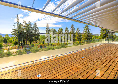 Cupertino, CA, United States - August 12, 2018: landscape from roof terrace of Apple Park Visitor Center overlooking the new futuristic Apple HQ with offices and Campus in Silicon Valley, California. - Stock Photo