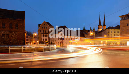 Germany, Saxony-Anhalt, Halle (Saale), dusk, light trails of tram and car, behind market church and Red Tower, - Stock Photo