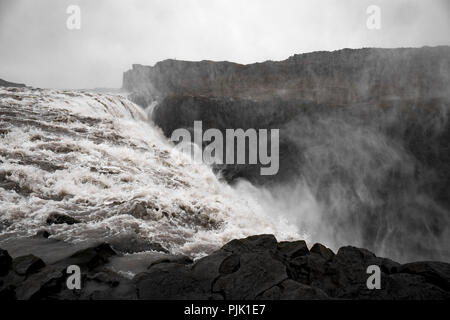 The mighty waterfall Dettifoss in a rough rocky environment - Stock Photo