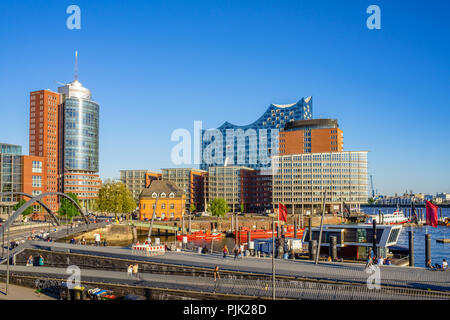 Hamburg, Germany - May 07, 2018: View from subway station Baumwall at Hafencity and strolling pedestrians at sunny weather in Hamburg, Germany. - Stock Photo