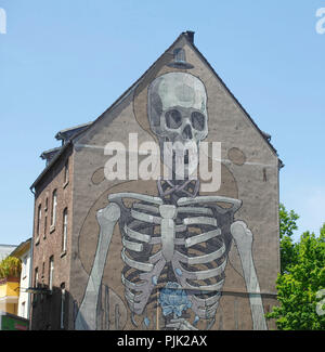 Painted house wall, skeleton on a residential building, old building in Bayernstraße, Severinsviertel, Cologne, North Rhine-Westphalia, Germany, Europe - Stock Photo