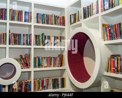 Corner of children's section with paperback books on shelves, Central Library, George IV Bridge, Edinburgh, Scotland, UK