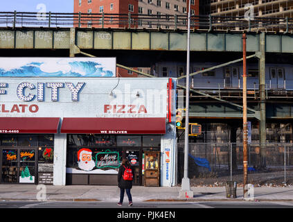 Pizza restaurant in Coney Island, Brooklyn, New York City, USA, in the background the subway, - Stock Photo