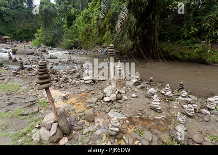 Cairns, stacked stones near the Tegenungan waterfall, Ubud, Bali, Indonesia - Stock Photo
